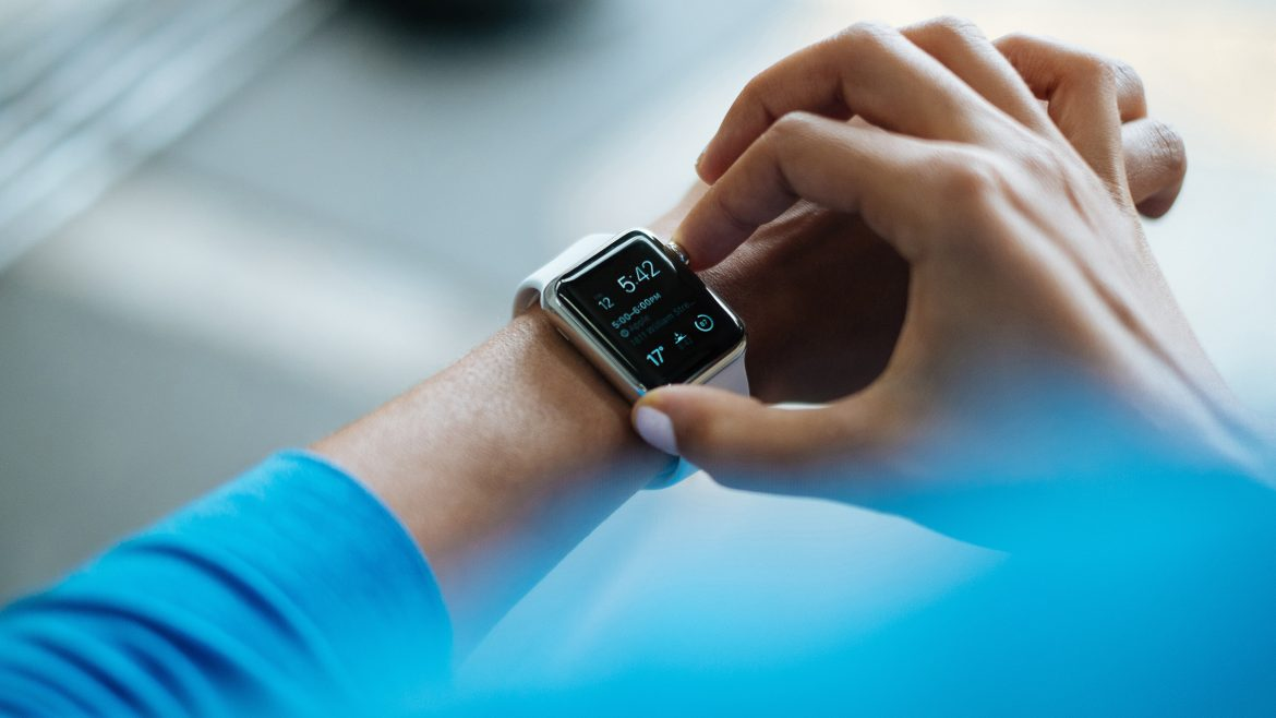 Person touching smart watch on his/her arm