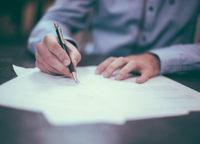 Man signing papers on a table