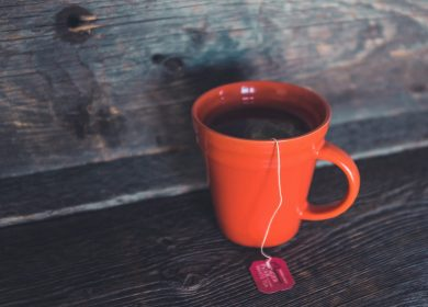 Red coffee cup with tea on a table