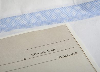 Corner of a business check on an envelope