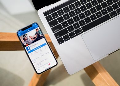 Smartphone next to a laptop computer