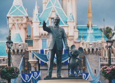 Statue of Walt Disney and Mickey Mouse in front of Sleeping Beauty's castle